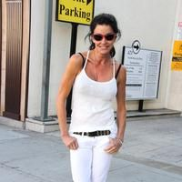 Janice Dickinson poses outside the Planet Blue store in Beverly Hills, California
